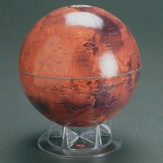 Mars Globe   The beautiful portrayal of the Martian surface was created from 6,000+ highly detailed images acquired by the Viking Orbiter, digitized to approximate Mars' true color.