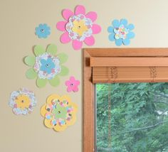 These paper flowers are easy to make and simple to hang up as a decoration in your child's room - just use removable Command™ Poster Strips!