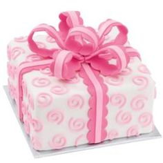 A rose scallop bow and fun swirls bring this pretty pink package cake to life!