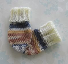 NEWBORN BABY MITTS - birth to 6 months size - (ivory and patterned baby yarn in shades of blue and brown)