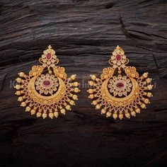 Unique antique swarnika earrings plated with gold polish studded with synthetic white and ruby stones and made of copper alloy Gold Jhumka Earrings, Jewelry Design Earrings, Gold Earrings Designs, Gold Jewellery Design, Antique Earrings, Diamond Jewelry, Jewelry Rings, Mens Sterling Silver Necklace, Silver Necklaces