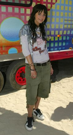 Ashlee Simpson in a silver sequined shrug and cargo shorts.