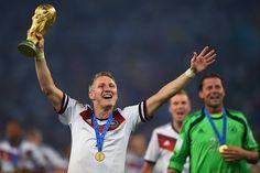 Bastian Schweinsteiger holding the World Cup