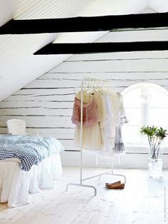 After selecting her outfits for the week, Pettersson Englander hangs them on a portable clothing rack in her attic turned dressing room #closet #dressing_room #organization