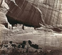 Settlement: View of the White House, Ancestral Pueblo Native American (Anasazi) ruins in Canyon de Chelly, Arizona, in 1873. The cliff dwellings were built by the Anasazi more than 500 years earlier. At the bottom, men stand and pose on cliff dwellings in a niche and on ruins on the canyon floor. Climbing ropes connect the groups of men. Anthropologists and archeologists place the Anasazi peoples of Native American culture on the continent from the 12th Century BC. Their unique architecture ...
