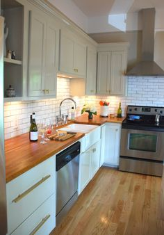 walls and cabinet color is Grant Beige by Benjamin Moore, countertops sealed with 3 coats of satin Waterlox