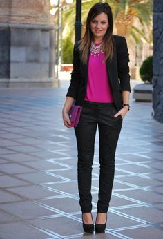 Fuschia top, black blazer and black slacks with statement necklace.