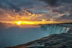 Horseshoe Falls Sunrise, Niagara Falls Ontario. Taken shortly after a similar shot I have posted.  In this image the sun has started to poke out of an opening in the clouds.