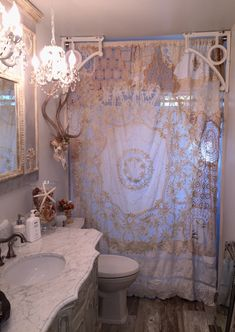 I made this shower curtain from old pieces of crochet and lace.