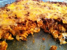 taco casserole      1 box twisty rotini noodles, cooked and drained  1 1/2 cups sour cream  Mix together and pour in to greased casserole dish  1 lb ground beef browned and drained  1/4 cup taco seasoning  1 can tomato sauce  Mix together and pour on top of the noodles  Sprinkle with grated cheese and bake at 350 degrees for 30 minutes