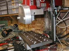 Surface Grinder - Homemade surface grinder constructed from a modified angle grinder, variable speed control, and a magnetic table.