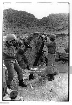 Iranian soldiers prepare a mortar launch onto Iraqi soil on the Allah Akbar front, near Ahwaz, Iran, during the Iran-Iraq War, 9th December 1980.