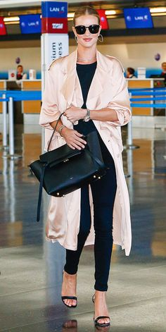 Rosie Huntington-Whiteley in a black top, skinny pants, blush pink satin duster coat and heels - click through for more spring outfit ideas from celebrities!