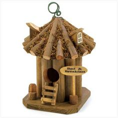 """item:12606) Available BED AND BREAKFAST BIRDHOUSE. Bed and breakfast birdhouses. Wooden birdhouse is 5"""" x 5"""" x 9"""" high. $14.95"""