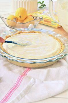 Easy No Bake Lemon Cheesecake Ice Box Pie with Lemon Oreo Crust Dessert Recipe spread batter via Dreaming in DIY