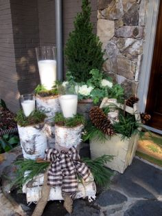 for porch...idea to note: use lantern on varying heights of birch logs w/ juniper greens