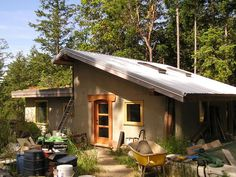 Small straw bale house with green roof-steel roof combo. Part of the eco-homes network