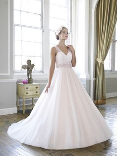 Ball gown, soft tulle is pleated and draped over the sweetheart bodice creating illusion sleeves. Simple wedding dress. Moonlight Style J6265.