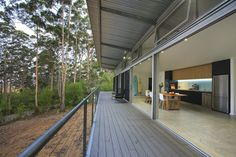 The House reconciles the otherwise opposing goals of biodiversity conservation and bushfire safety. It also addresses misconceptions that building to high bushfire standards is cost prohibitive. Bunker Home, Masonry Wall, Commercial Construction, Concrete Floors, Cladding, Black House, Sustainability, Building A House, Backyard