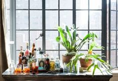 A kitchen island is repurposed as a makeshift bar in the living room, ideal for entertaining.