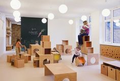 Children roam amongst colourful critters at this new kindergarten designed by Baukind