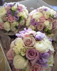 `Creme de Menthe` roses, `Pacific Blue` roses, mauve sweet pea, white ranunuculus, white freesias and `Bianca Candy` roses