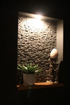 stone wall niche...what a terrific idea for the home. i don't like the lamp. skylight maybe? or open top with rocks on the ground to prevent mud going mad when it's rain