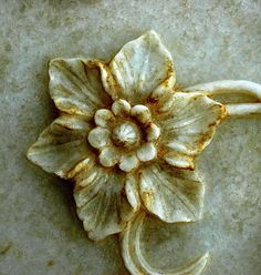 A small floral-motif, in marble, on a wall of the Taj Mahal, Agra, India