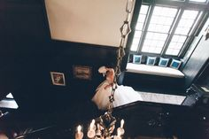 Bride descends the stairs at the Castle on the Hudson in Tarrytown, NY. Captured by NYC wedding photographer Ben Lau.