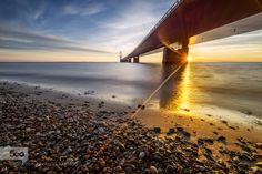 The Great Belt bridge by thomasmorkeberg  water bridge denmark ocean sea summer sunset belt blue coastline connection danish fixed funen great