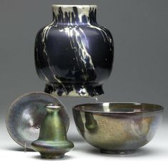 Four vessels in assorted lustered glazes: St. Lukas (Utrecht, Holland) vase; Carters (Poole, England) hemispherical bowl; De Porceleyne Fles small bowl; and Bacs (Golfe-Juan, France) cabinet vase. All marked. Tallest: 7 1/2''