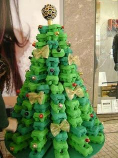 Christmas tree made from (green) egg cartons. Decorated with Nespresso cups and ribbons.