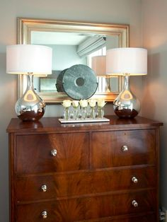 Modernize a favorite heirloom with streamlined pulls that coordinate with the room's decor. Because the original hardware increases an antique's value, store it in a labeled container should you ever wish to replace it. Design by RMSer Patrick.