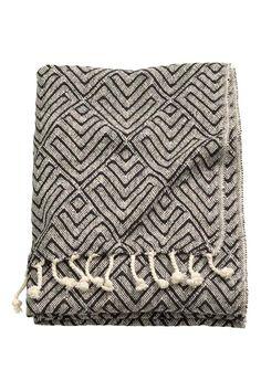 Manta de algodón en jacquard: Manta de jacquard en tejido de algodón. Flecos en los lados cortos.