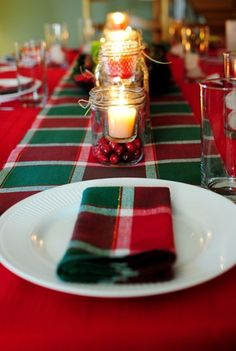 I love this idea for centerpieces at Christmas...jars with cranberries and candles!