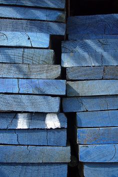 Stacks of blue painted boards