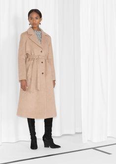 Fully lined Two waist pockets  Model wears: EU 36/ UK 10/ US 6    Length of coat: 115 cm (size 36)