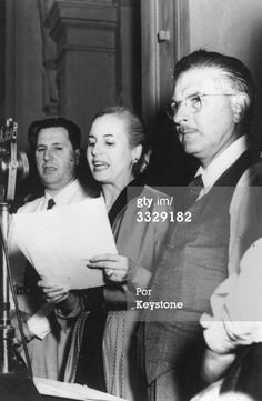 24th October 1949: Eva Peron (1919 - 1952), the second wife of Argentinian president Juan Peron, reading her message to the people during celebrations to mark the fourth anniversary of her husband's government. Beside her on the balcony of Casa de Gobierno (Government House) in Buenos Aires are Juan Peron (left) and Colonel Mercante, governor of the province of Buenos Aires. (Photo by Keystone/Getty Images)