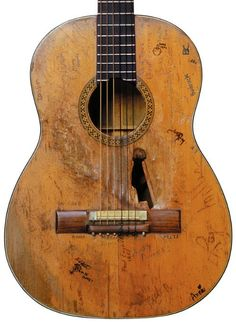 Willie Nelson's guitar - looks like it's had a good, long time of making music.