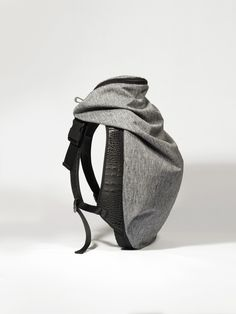 Nile Rucksack Fashion's appropriation of architectural principles has contributed to the evolution of the Nile collection. A recasting of our iconic Isar Rucksack, with its complex interplay between form, space and practicality, the Nile rucksack effortlessly balances innovative modern fabrics and architectural shapes, to ensure every backpack not only accompanies the journey of universally minded intrepid users, it complements it.With fabrics that are informed by minerals ...