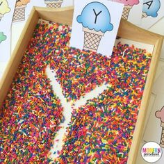 Free printable ice cream alphabet writing practice cards for this super simple sprinkle filled writing tray! Practice pre-writing and fine motor skills.