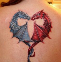 Tattoo cute dragons in a heart