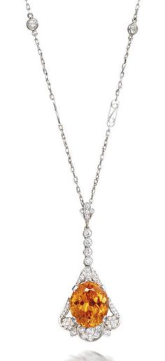 A spessartite garnet and diamond necklace, by Tiffany & Co. The oval mixed-cut spessartite garnet within a stylised openwork surround set with brilliant-cut diamonds, suspended from a surmount and trace-link chain set with similarly cut diamonds, pendant mounted in platinum, diamonds approximately 0.80 carat total, pendant signed Tiffany & Co.