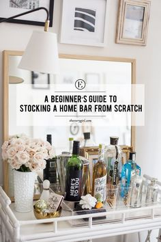 a beginner's guide to stocking a home bar from scratch! tons of great tips for your bar cart!