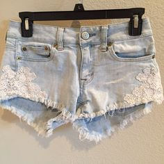 Laced AEO Shorts Cute light denim shorts with lace detail from American Eagle. In good used condition. American Eagle Outfitters Shorts