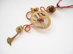 Buy Unique-Handmade Jewelry-Wire wrapped-Steampunk Pendant-Pearl-Eye of Tiger Bead-Brass Cuckoo clock Parts-Red Wax cord-Sliding knots by annarecycle. Explore more products on http://annarecycle.etsy.com