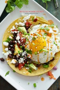 Huevos Rancheros: This Mexican breakfast or brunch is amazing! It can be seasoned with Mexican spices & fresh pico de gallo; add in pinto beans & serve this dish with a few delicious salsas. One of my favorites is a smoky chipotle sauce. Breakfast Desayunos, Breakfast Dishes, Breakfast Recipes, Mexican Breakfast, Pancake Recipes, Breakfast Sandwiches, Waffle Recipes, Breakfast Ideas, Huevos Rancheros