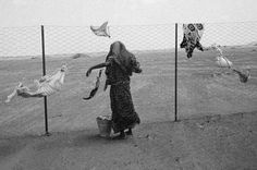 Nikos Economopoulos  Aden. Hiswa camp for Somali refugees. A woman doing the family laundry. At the end of 1992, just before the arrival of the U.N. troops, 700 Somalians fled the civilian war in their country and took refuge in Yemen, bringing the number of Somali refugees up to 60 000.