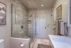 Contemporary 3/4 Bathroom with Limestone counters, High ceiling, Flush, Undermount sink, limestone tile floors