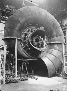 c. 1930, Building spiral turbines. Sheet metal.